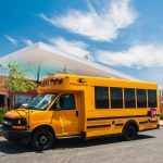 Image of Blue Bird - Micro Bird - Type A School Bus from A-Z Bus Sales parked in front of a Southern California School