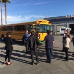 A-Z Bus Employees gather around new Blue Bird Type D transit electric school bus