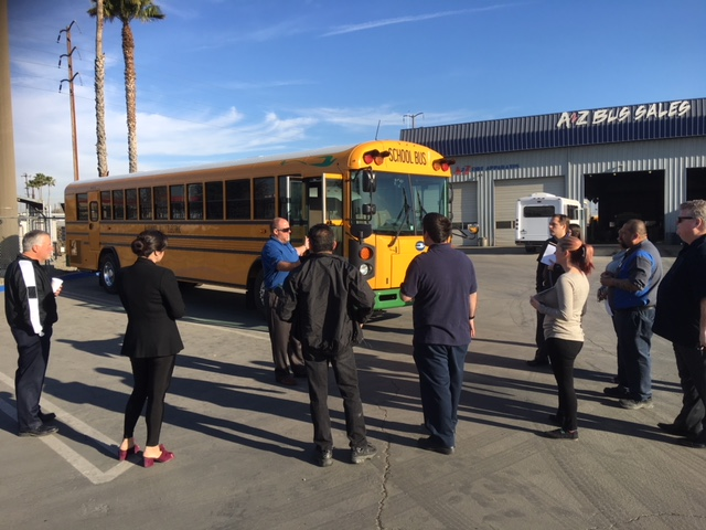 A Z Bus Employees Gather Around New Blue Bird Type D Transit Electric School