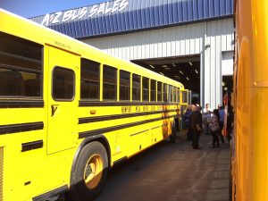 Child Safety Alert System Demonstration at A-Z Bus Sales with Blue Bird School Buses in foreground